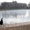 "Tribune-Star/Joseph C. Garza<br /> Cold? What cold?: Rose-Hulman sophomore Hobey Tam of Fishers walks in shorts along a frozen pond in Tuesday's frigid temperatures on the engineering school's campus. ""It's only a 10 minute walk,"" said Tam about his trip from his class to his dorm."
