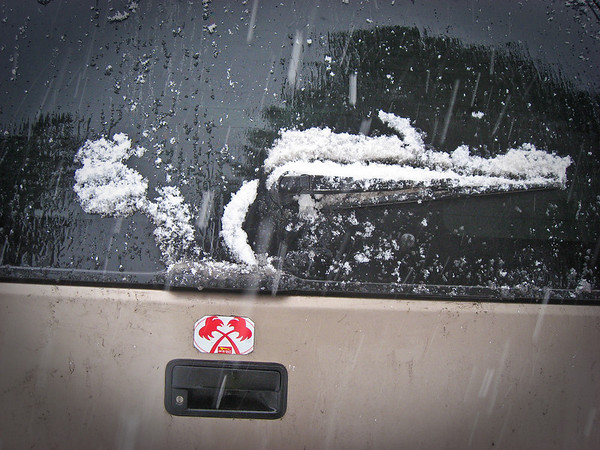 Doesn't this look like a gun of some sort? It's actually how the snow fell on John's Suburban's back windshield wiper