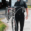 Tribune-Star/Joseph C. Garza<br /> Light and lightning fast: Father Rick Ginther picks up his bicycle to show how light weight it is near St. Margaret Mary Church Thursday. The bike is the one he will use for the RAIN ride Saturday.