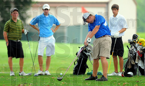 Watching and waiting: Watching Sam Pollock tee off are Shelby Stewart, Brandon Bekkering and Cory Gertz.