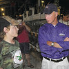 Grand Champion: Noah Boyce talks with  Mitch Daniels about his rabbits during the governor's visit to the Vigo County Fair Thursday afternoon. Boyce won Grand Champion Meat Pen for his entry.