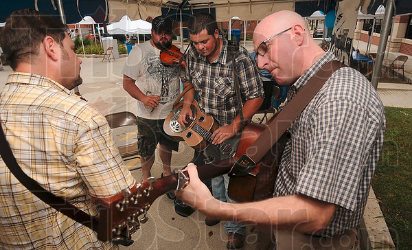 "Tribune-Star/Joseph C. Garza<br /> Members of the Wire Mashers, John Wheat, Matt Dickerson, Bill Dickerson and Rob Miller perform ""Salt Creek"" Thursday at the Blueberry Festival."