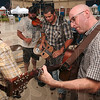 "Tribune-Star/Joseph C. Garza<br /> Members of the Wire Mashers, John Wheat, Matt Dickerson, Bill Dickerson and Rob Miller perform ""Salt Creek"" Thursday at the Blueberry Festival."