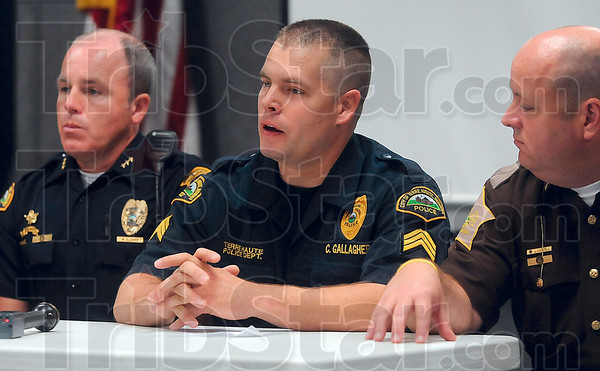 Tribune-Star/Joseph C. Garza<br /> Working to stop the scourge: Terre Haute Police Department Sgt. Chris Gallagher, center, discusses law enforcement's effort to curb the sale of products that contain pseudoephedrine which are then used to manufacture methamphetamine during a press conference Thursday at the Vigo County Sheriff's Department.