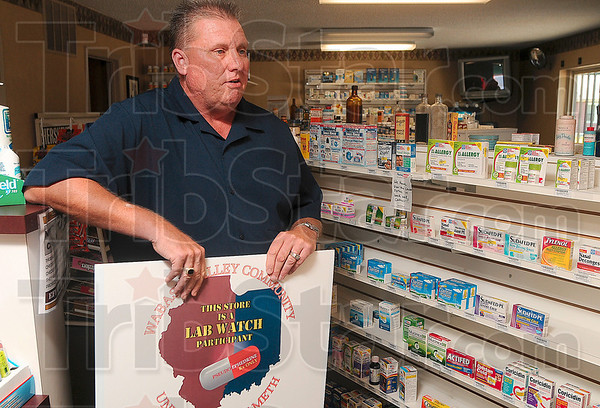 Tribune-Star/Joseph C. Garza<br /> The sign will be posted: Terre Haute Prescription Shop owner John Love talks about the effort by individuals to purchase large amounts of products that contain pseudoephedrine for the manufacture of methamphetamine Thursday at his Seventh Street business.