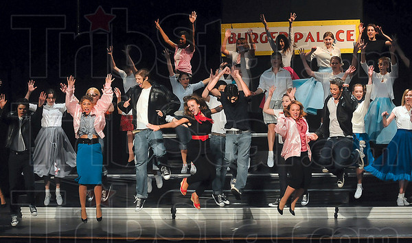 "Tribune-Star/Joseph C. Garza<br /> Up together: The cast of ""Grease"" jump in the air during the final song, ""We Go Together,"" of the 2010 Performing Arts Workshop's production of the popular musical Thursday in the West Vigo High School auditorium."