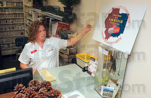 Tribune-Star/Joseph C. Garza<br /> No prescription, no pseudoephedrine: Pharmacist Erin Haggart of JR Pharmacy places one of the Lab Watch signs near the front counter of the pharmacy Thursday at Southland Shopping Center.