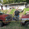 Evidence collection: Sheriff's department Crime Scene Investigator John Moats leaves the scene of an early morning homicide near Prairieton.