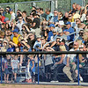 Fans: Rex fans shield their eyes from the late afternoon sun at Bob Warn Field Thursday evening. The fans and team celebrated the 20th Anniversary of the Americans with Disabilities Act.