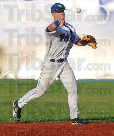 Gotcha: Rex second baseman Koby Kraemer fires a fielded ball to first base for the out during game action Thursday night.