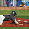 Race to the base: Nashville's #12, Johnny Amann dives back into first base just as the ball arrives to Joe Meggs from pitcher Michael Son during a pick-off attempt. The runner was safe on the play.
