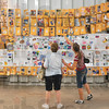 Tribune-Star file photo/Joseph C. Garza<br /> Recycled into art: 4-H volunteer leader Bethany Gisel, right, shows some of the work created by students she worked with earlier in the year to her mother, Jeanette Riggs, Tuesday, July 14, 2009 at the Wabash Valley Fairgrounds.