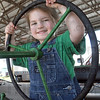 Tribune-Star file photo/Bob Poynter<br /> Oh Deere: Elizabeth Boling takes the wheel of a John Deere tractor at the Vigo County 4-H Fair Monday, July 13, 2009.