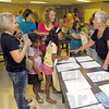 Check-in: Veteran 4-H leader Carol Turner, right, helps with the check-in process for the sewing competition Thursday evening at the Wabash Valley Fairgrounds.