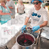 Tribune-Star file photo/Joseph C. Garza<br /> Hat, gloves, berries: Don Richards of Terre Foods gathers a helping of blue berries for a serving of ice cream and berries during the Terre Foods Blueberry Festival Thursday, July 16, 2009 at the Central Presbyterian Church on north Seventh Street.
