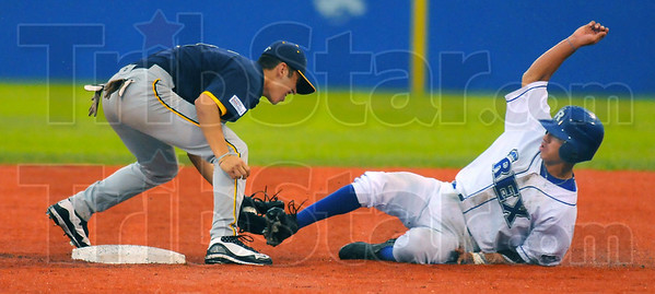 Caught: River Rat short stop Zach Bott tags Ray Hernandez  out as he tries to steal second base in third inning action Thursday night.