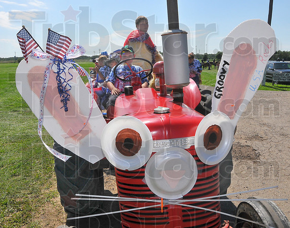 Tribune-Star file photo/Jim Avelis<br /> I'm all ears: The Rabbit Barn entry in the 4-H Celebration Parade was easy to pick out of the line of tractors, floats and hay wagons July 16, 2009 at the Vigo County Fair.