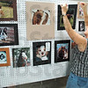 Tribune-Star file photo/Bob Poynter<br /> Photo exhibit: Lisa Wilson prepares the open photo exhibit for judging Saturday, July 11, 2009 at the Vigo County Fairgrounds.