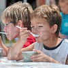 Tribune-Star file photo/Joseph C. Garza<br /> Less talk, more berries and cream: Eight-year-old Austin Alexander, right, and his brother, Adam Alexander, enjoy spoonfuls of blueberries and ice cream during the Terre Foods Blueberry Festival Thursday, July 16, 2009 at the Central Presbyterian Church on north Seventh Street.