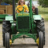Still rolling: Theresa Watson guides a Model 1934 GP John Deere tractor in the Parade of Power Sunday afternoon at the Vigo County Fair.