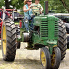 Power on parade: Andy Curry and his mom Jennifer take part in the Antique Tractor Parade of Power Sunday afternoon at the Vigo County Fair.