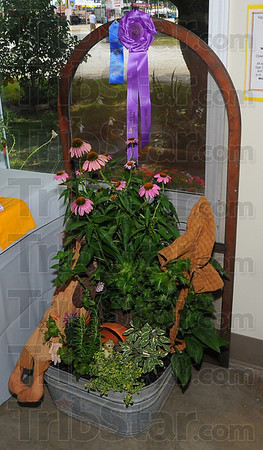 Best: Lori Morris' arrangement of coneflowers and herbs won her Grand Champion status at the Vigo County Fair.