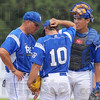 Can we talk?: Rex assistant coach John Gardner, left talks with pitcher Alex Sachs while catcher Alex DeLeon listens in.