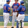 Calming: Post 346 manager John Hayes talks with his pitcher #15, Shawn Walker and catcher #13, Seth Lunsford during early inning action Sunday.