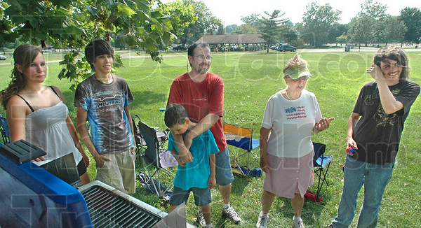 Family fireworks: Wayne Taylor (red shirt)  and his sons Steven, Christopher and Joey visit with their grandmother Diana Taylor and Melissa Shaw Sunday afternoon as they setup a campsite for the annual fireworks display.