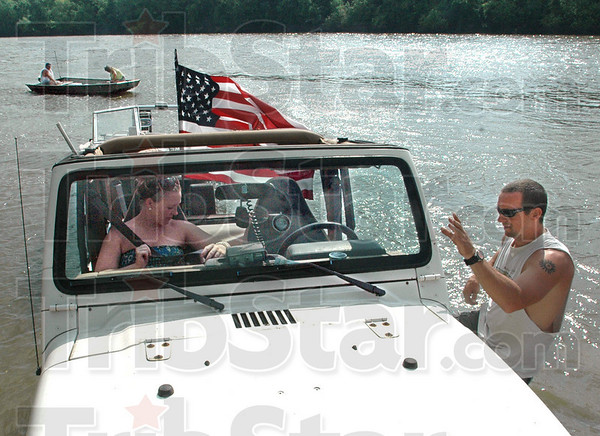 Fasten you seatbelts: Charles Roach and Brandi Larson prepare to pull their boat out of the Wabash River at Fairbanks Park Sunday afternoon. The couple spent about three hours cruisin' the Wabash.