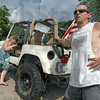 Cruisin' the Bash: Brandi Larson uses her hand to push on the brake of Charles Roach's Jeep as they remove their speedboat fromt he Wabash River Sunday afternoon. The couple spent about three hours cruisin' the bash.