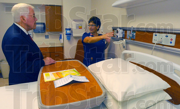Cutting edge: Senator Richard Lugar listens to Union Hospital nursing care manager Karen Branam explain how technology has helped in her profession.