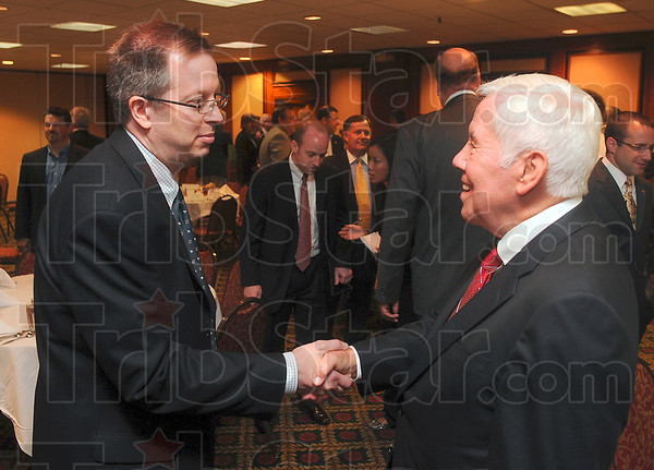 Tribune-Star/Joseph C. Garza<br /> Law and government: Attorney Scott Racop greets Sen. Richard Lugar after Lugar's speech to the Chamber of Commerce Friday at the Holiday Inn.