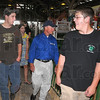 Best foot forward: Cody Steele, right, was one of the 4-H members chosen to show Governer Mitch Daniels around the fair grounds Thursday. With them are Daniel Sedletzeck, left, and Tressa Steward.