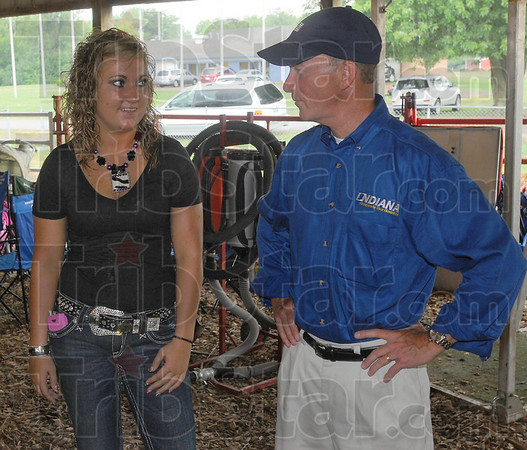 Meet the Governor: 4-H member Bailey Fitzpatrick talks with Governor Mitch Daniels Thursday afternoon during his tour of the Vigo County Fair.