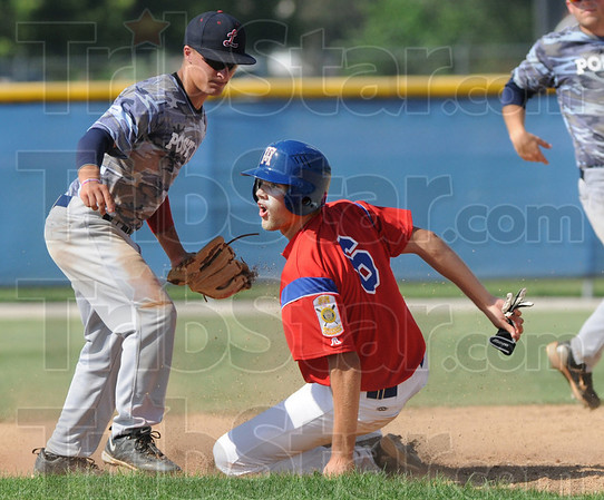 Say what?: Parker Fulkerson looks to the umpire for a call as he slides into second base against Vincennes Friday afternoon. He was called out on the play.