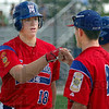 Two of a kind: Post 346 pitcher A.J. Reed gets a fist bump from Jacob Hayes after hitting a home run against Vincennes Post 11 Friday afternoon. Jacob Hayes also had a home run as the first batter of the game.