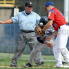 Safe: The base umpire calls a Vincennes runner safe as Post 346 first baseman Dougie Collett flips the ball into his glove during a pick-off attempt Friday afternoon.