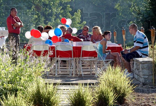 "Outdoor setting: Some of the people attending the ""Light up the Wabash"" celebration Friday evening chose the patio area with tiki torches and citronella candles helping to keep the bugs at bay"