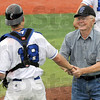 Thanks for the years: Eighty-five-year-old Buck Gillin gets congratulated by Rex catcher #18 Braden Kline after throwing out the first pitch of Friday's game against Dupage. Gillin coached at Southside Little League for 26 years.