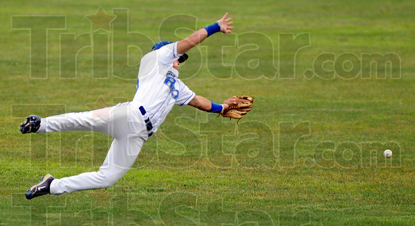 Mr. Hustle: Rex second baseman Koby Kraemer dives for a ball just out of reach during game action Friday night.