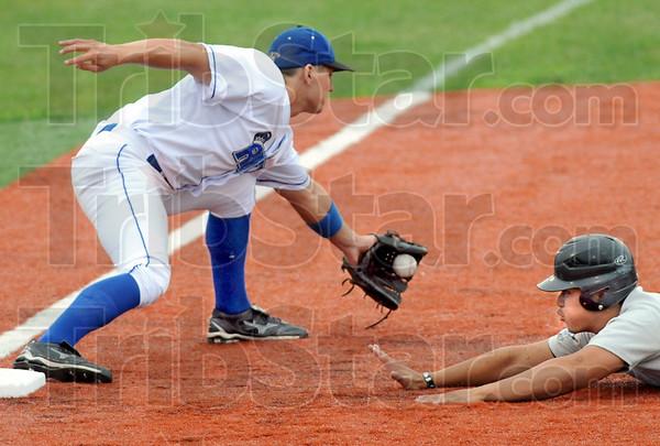 Not: Rex third baseman #19, Alex Guthrie fields a throw as a Dupage player dives safely into the bag.