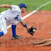 Not: Rex third baseman #19, Alex Guthrie fields a throw as a Dupage player dives safely into the bag.