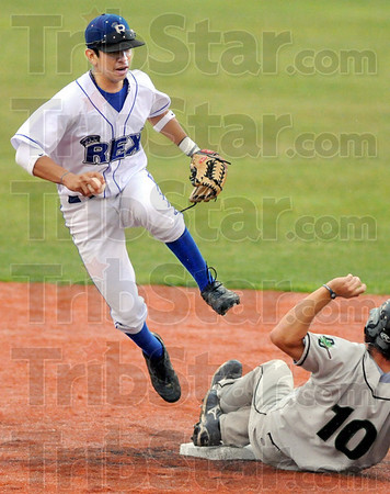 Gotcha: Rex shortstop Ray Hernandez jumps out of Dupage's #10 Seth Batty during Friday's game at Bob Warn Field.