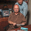 Tribune-Star/Joseph C. Garza<br /> Back in the USA: Dr. Randy Stevens, seated, and Dr. Alexander Ton recently returned from Vietnam where they saw many of the places they served and lived respectively when they were in the country when they were younger.
