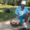 Tribune-Star/Joseph C. Garza<br /> It's what's cookin': Leon Clark grills chicken for New Haven of Hope's fundraiser Saturday at the corner of 16th Street and Liberty Avenue Saturday.