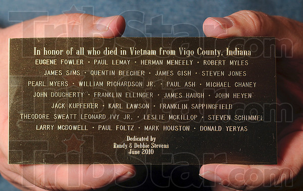 Tribune-Star/Joseph C. Garza<br /> For those who didn't make it back: Dr. Randy Stevens displays June 2 the plaque he took to Vietnam to bury that features the names of the service members from Vigo County that died in the Vietnam War.