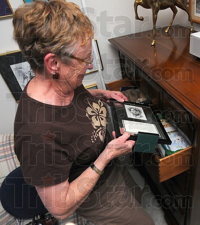 See you later: Louise Patterson slides her Bobby Kennedy memoribilia into a drawer when Herb's more conservative friends come calling.