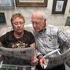Common interests: A bond for Louise and Herb Patterson is the Wall Street Journal. They pose here to illustrate their attachment to the paper and each other.