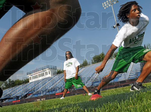 All Star camp: New York Jets cornerback Marquice Cole (L) watches players during an early morning workout at North high school Saturday morning.